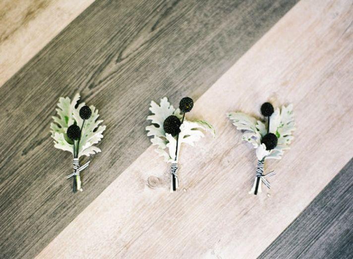 elegant wedding boutonnieres berries velvet leaves