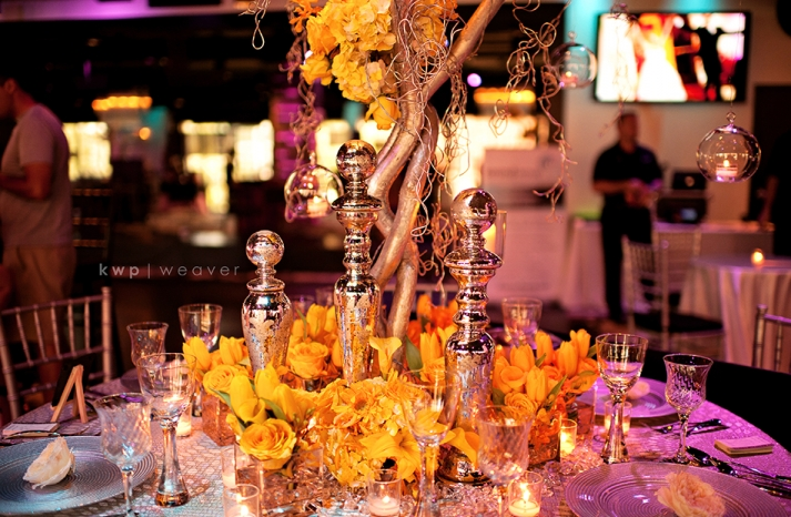 artistic wedding photography elegant indoor venue branchy centerpieces 2