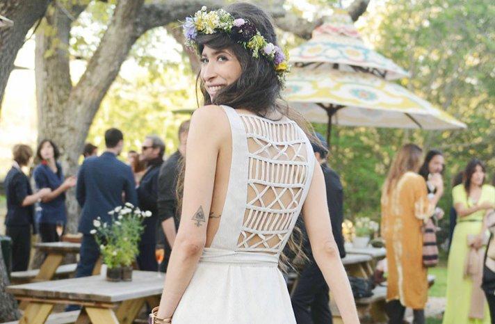 celebrity wedding simple bohemian vibe statement back wedding dress