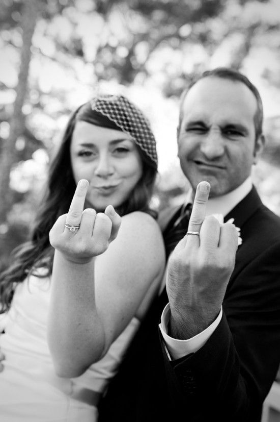 priceless wedding photos bride groom give finger