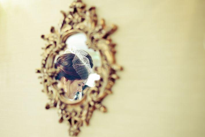 Georgia bride wears birdcage veil chic chignon