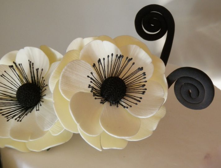 cream black wedding cake topper anemones