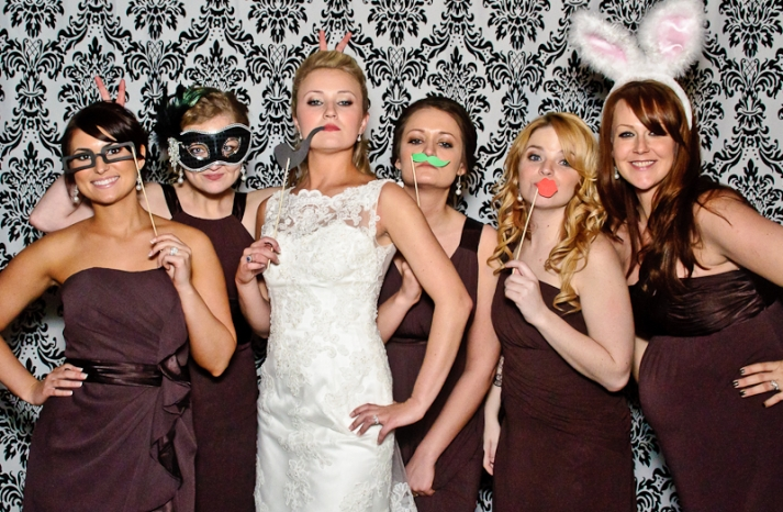 Bride and Bridesmaids Pose in Photo Booth