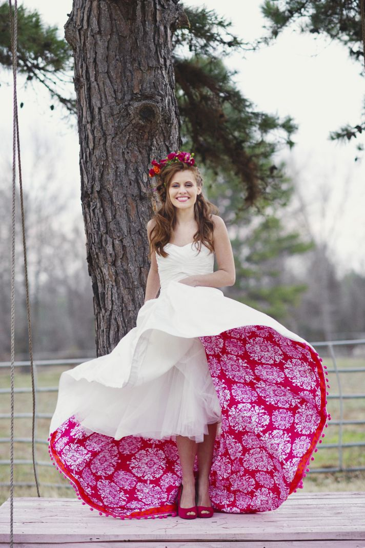 Romantic Bride Poses on Swing Shows Off Pink Petticoat