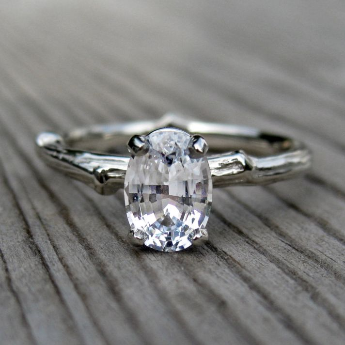 Oval engagement ring with rustic twig band