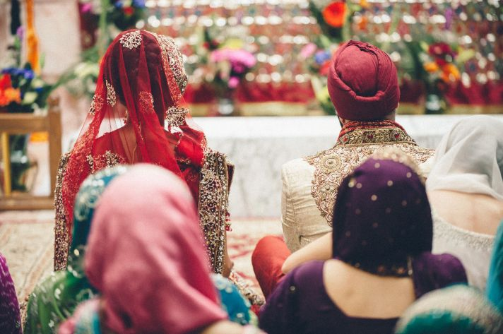 Indian Wedding Ceremony Guests Seated on Floor