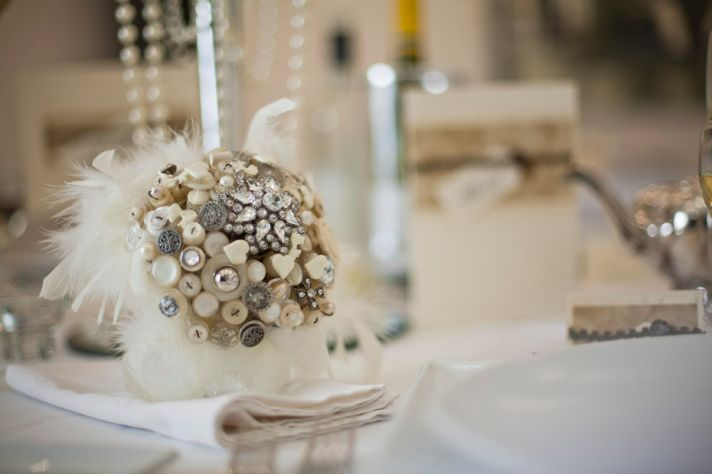 Vintage glam wedding bouquet of buttons brooches feathers