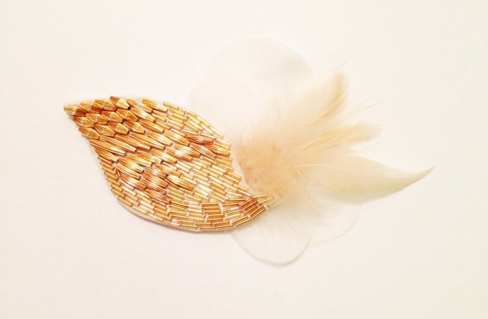 Gold wedding hair accessory with cream feathers