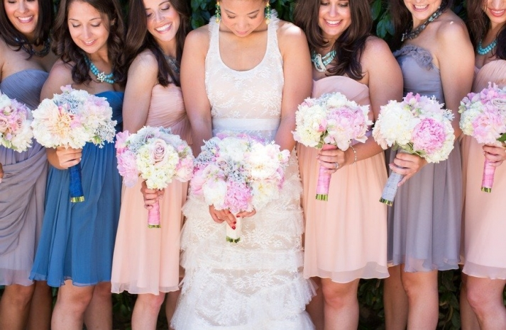 Romantic bride with bridesmaids in shades of blush lilac blue