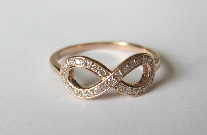 Yellow gold and diamond infinity wedding ring