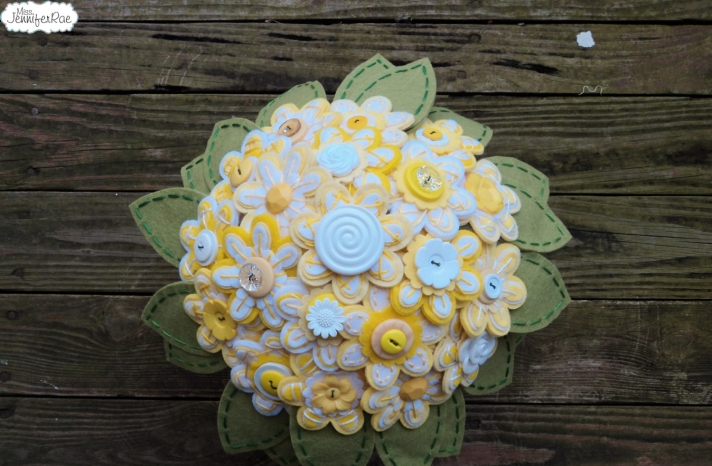 White and yellow daisy button wedding bouquet