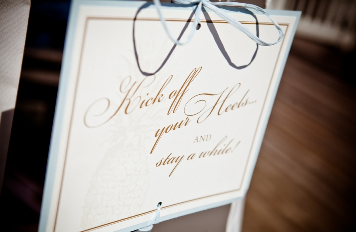 Elegant wedding sign inviting guests to kick off their shoes