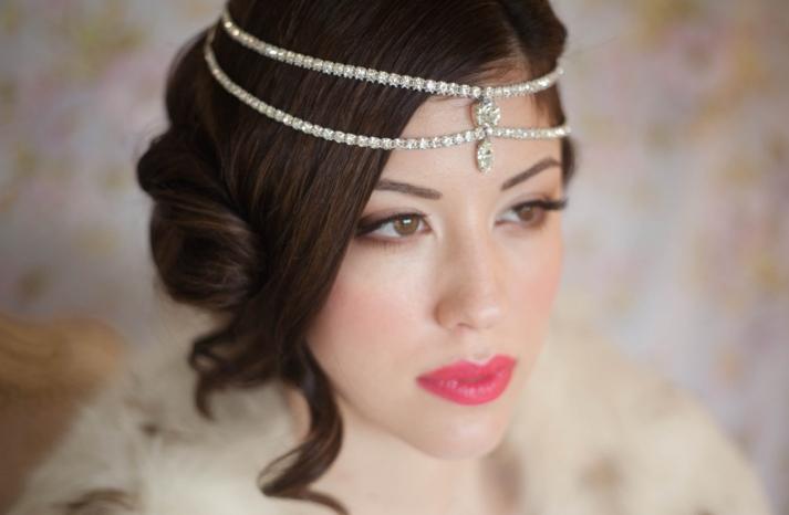 Silky wedding updo with tendrils crystal bridal headdress