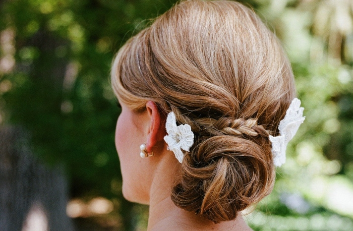 Low twisted bun wedding hairstyle with braid