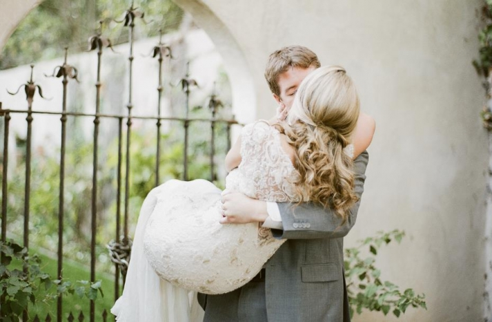 Bride wears half up wedding hairstyle Sarah Janks bridal gown