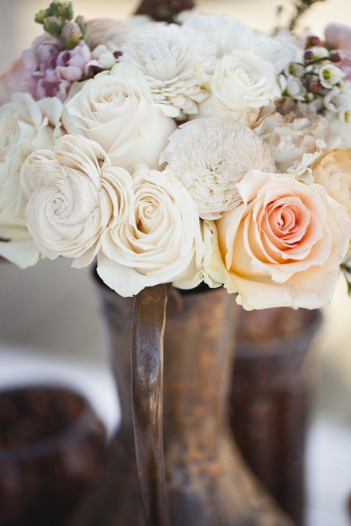 Romantic wedding centerpiece in vintage vase