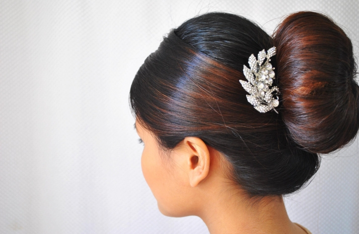 Sleek bridal bun with crystal hair comb