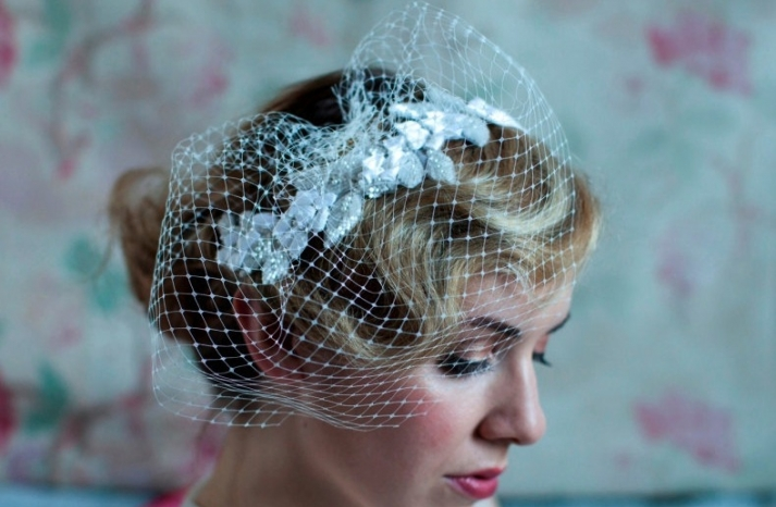 Retro roll updo with birdcage veil