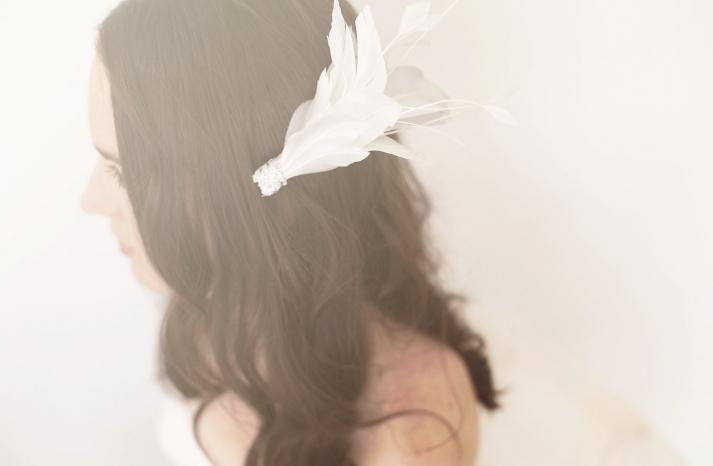 glamorous white feather wedding fascinator