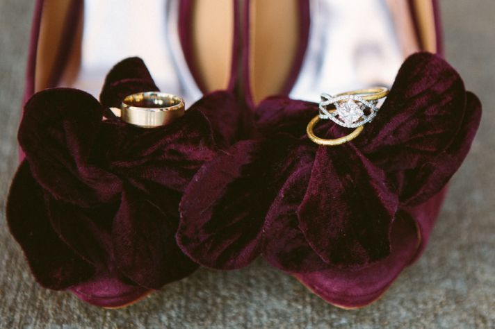 elegant velour wedding shoes with rings photographed on top