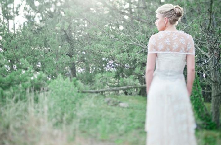 Sheer lace bridal bolero over Claire Pettibone wedding dress