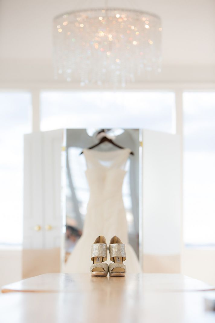 Silver jimmy choo wedding shoes photographed with gown