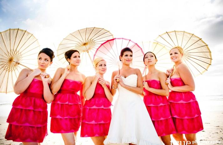Hot pink short bridesmaid dresses with beach parasols