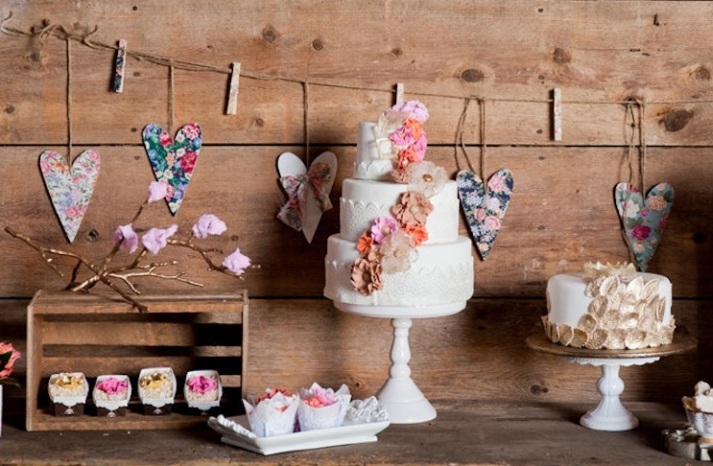 Rustic wedding cake table floral heart bunting