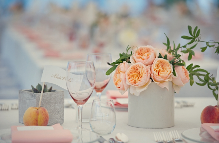 Sweet peach wedding tablescape with garden rose centerpiece