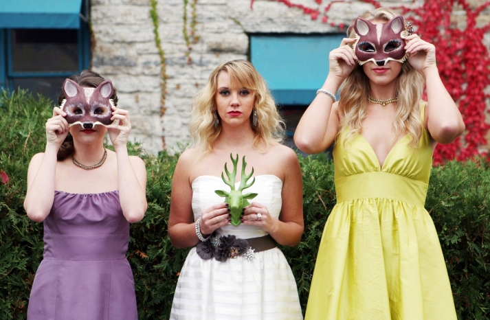 bridesmaids in masks with classic art deco bride