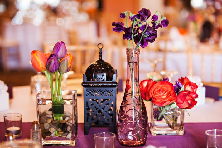 Orange and purple wedding flowers at oregon reception