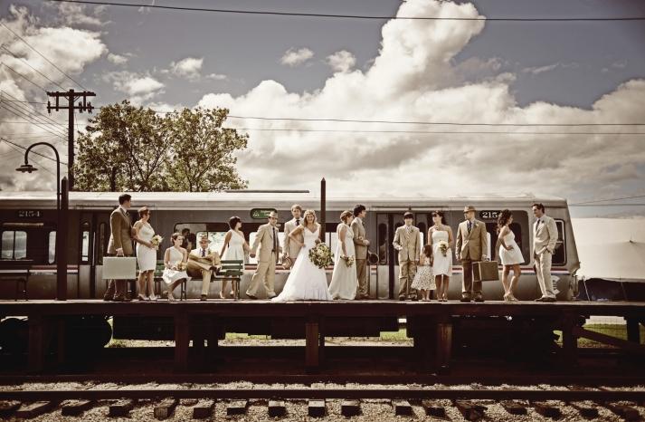 Vintage wedding party photo train runs by