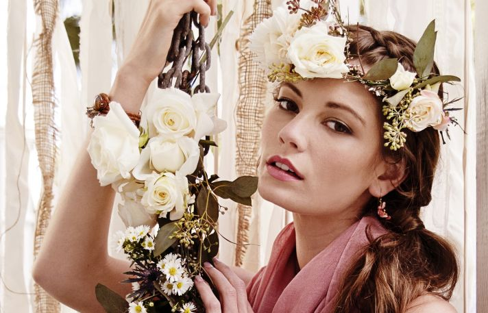 Bohemian bride wears floral crown and wrist corsage