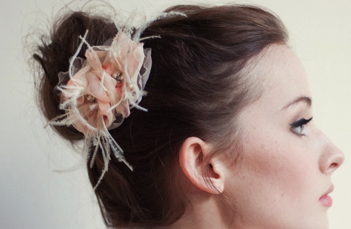 Blush pink wedding hair flowers with feathers