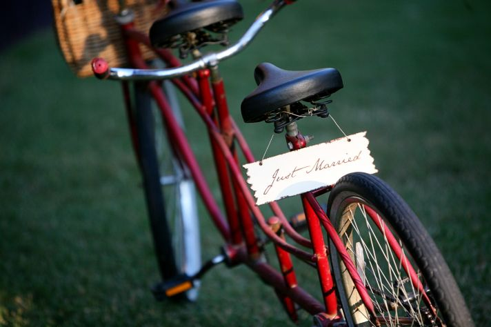 red bike adorned with Just Married sign
