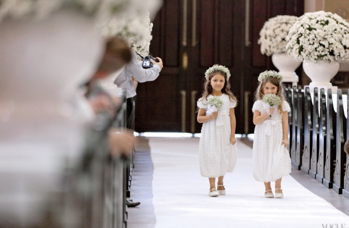 Adorable flower girls with babys breath crowns walk ceremony aisle