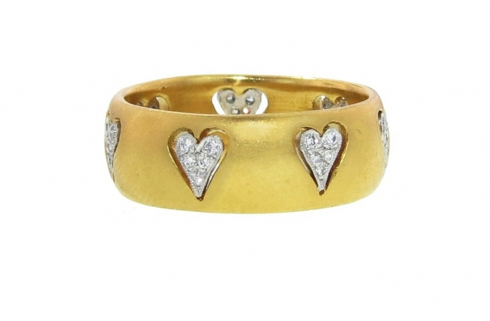 Floating hearts wedding band in yellow gold
