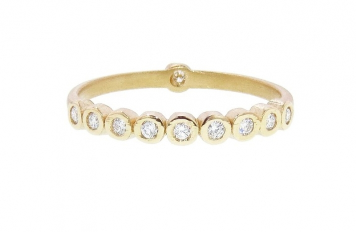 Yellow gold with diamonds bezel wedding band