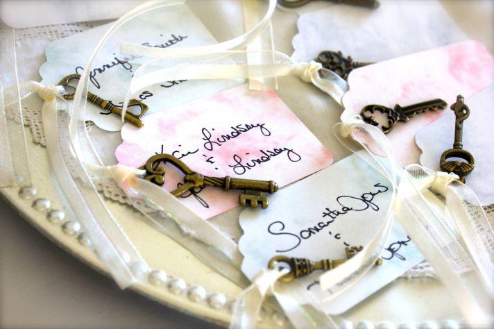 Pastel watercolor escort cards with skeleton keys