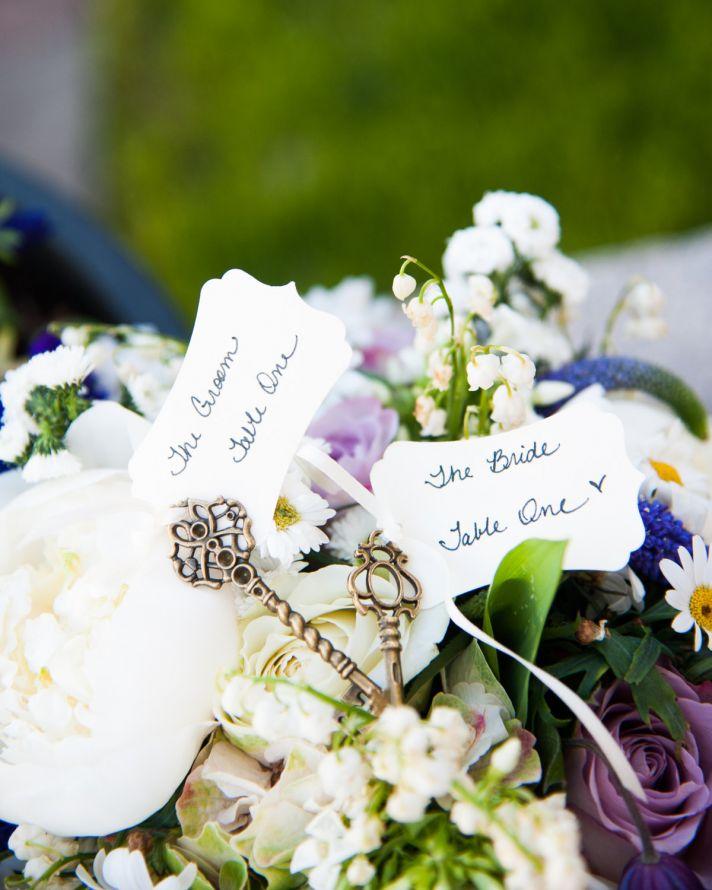 Elegant wedding escort cards atop reception centerpieces