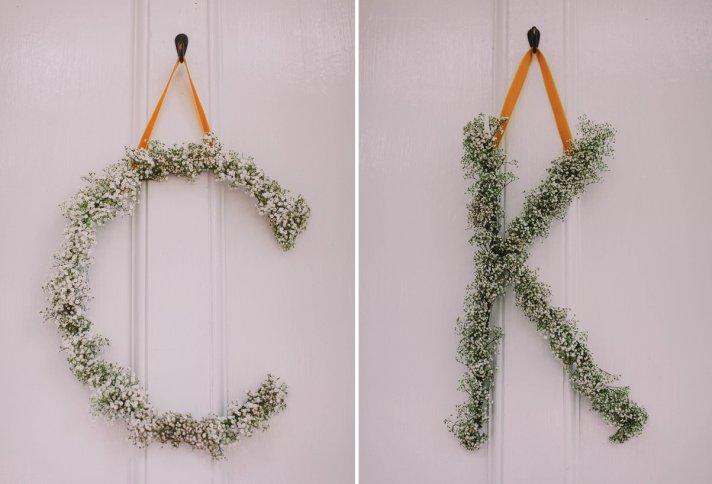 Romantic babys breath wedding initials hang on ceremony door