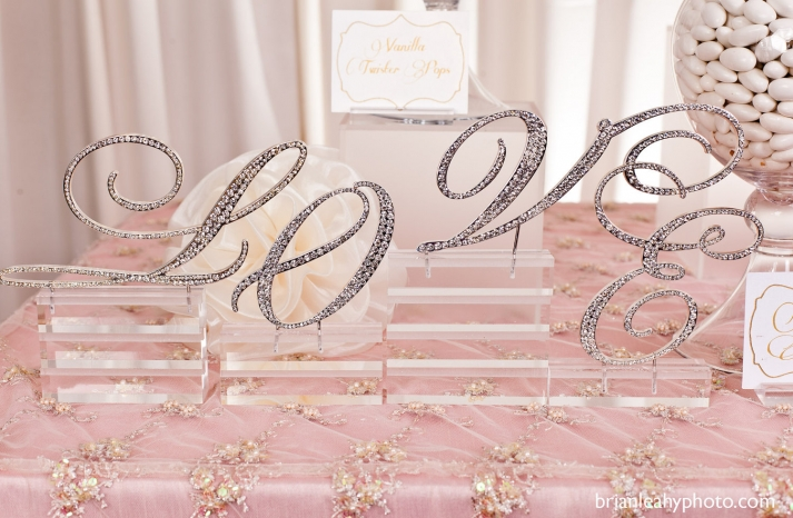 Sparkly love wedding sign featured on reception dessert table