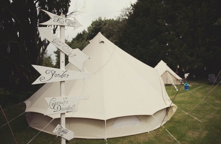 Glamping vintage wedding outdoors tents and unique signs