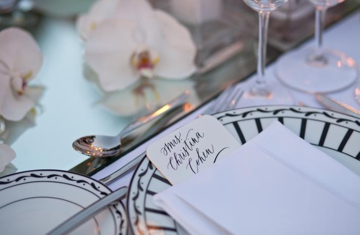 Elegant black and white deco inspired wedding place setting