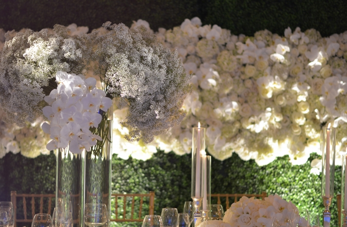 floral wedding backdrop with orchids roses hydrangea and babys breath