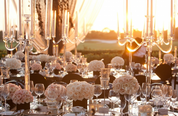 sunset wedding reception with modern candelabras and centerpieces