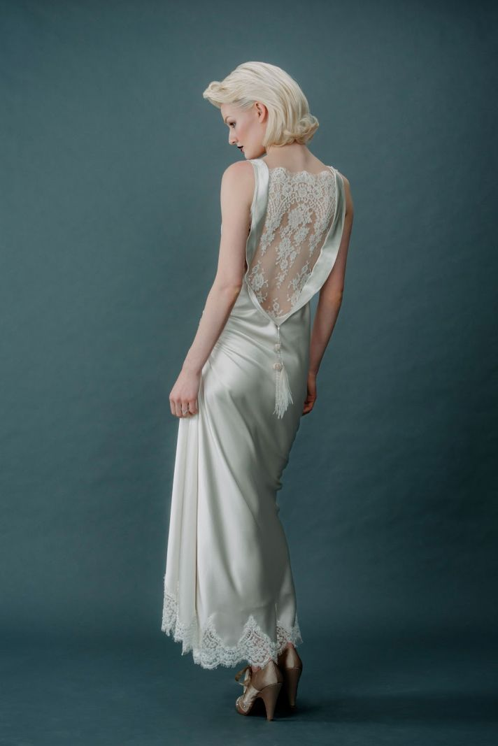 Sleek silk wedding dress with lace statement back