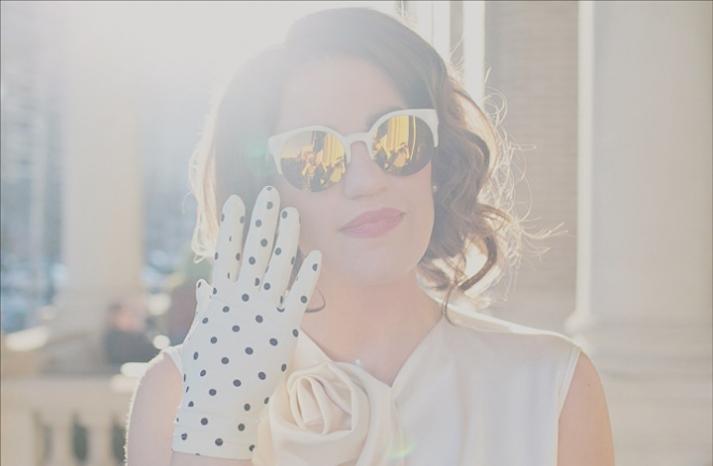 retro bride dons shades and polka dot gloves