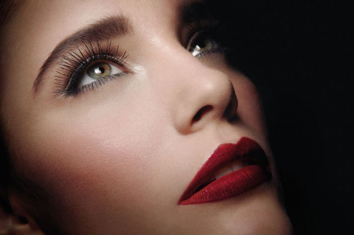 Timeless wedding makeup with long lashes deep red lips