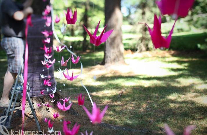 hot pink cranes create a stunning wedding backdrop